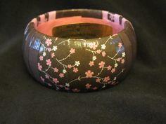 Brown and pink floral decoupage bracelet. $20.00, via Etsy.