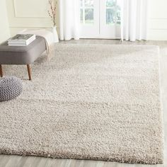 Safavieh California Cozy Solid Beige Shag Rug (8' x 10') |... (620.850 COP) ❤ liked on Polyvore featuring home, rugs, cream colored rugs, cream area rug, beige shag rug, off white shag rug and ivory rugs