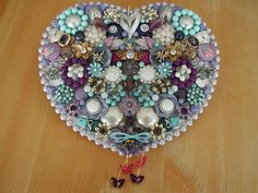 Jewelry heart I made for my daughter.  I used a lot of her old jewelry and even one of her little girl hair barrettes.  I love making these.  I LOVE jewelry!