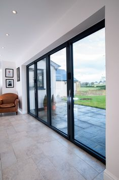 REAL Aluminium bi-folds feature neatly folding and sliding door panels up to wide and high built to the configuration of your choice. Bifold Doors Onto Patio, Sliding Door Panels, Sliding Door Window Treatments, Patio Doors, Sliding Glass Door, Glass Doors, Bifold French Doors, French Doors Patio, Aluminium Glass Door