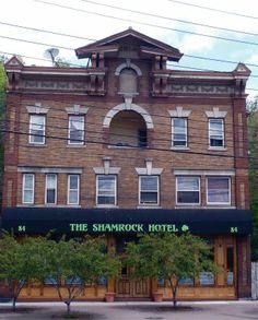 Main Street The Shamrock Hotel Restaurant Live Music Catering Linoleum On A Flatiron Style Building