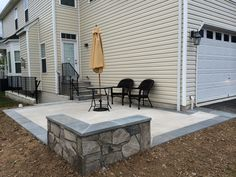 Charmant Concrete Patio With A Stone Seating Wall And Flagstone Border In Aldie,  Virginia.