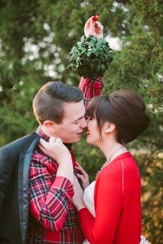 Christmas kiss under the mistletoe! // photo by HaleySheffield.com <-- Seriously love the retro feel of this...THAT hair!! And I'm talking about both of them! Haha