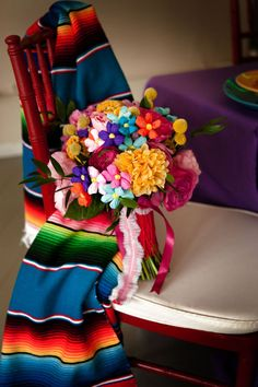 Sarape and flower adorned chair.