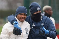 Wearing a snood, De Gea kept the thumbs up as he posed for a photo with Antonio Valencia