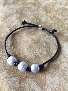 Fresh water pearls on dark leather.