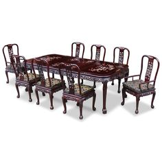 96in Rosewood Queen Ann Grape Motif Dining Table with 8 Chairs.  Intricately inlayed with mother-of-pearl flowers decorate the entire table top and the chairs, table and chairs are laced with hand-carved grape motif along the edges. Dark cherry finish. Oriental Rosewood dining set.