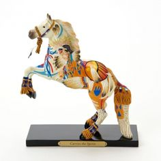 Carries the Spirit Painted Pony Collector's Item. Carries the Spirit is standing tall and proud on its hind legs, as if stepping to the beat of a drum at a powwow. This rearing white stallion has caught the spirit of the two Native dancers in dazzling regalia, who spin and leap dramatically, fringe and feather blowing like grass in the wind.