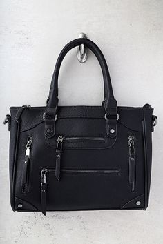 """The Across-the-Board Black Handbag exceeds all our expectations! Chic vegan leather handbag with a multitude of zippered pockets at front and back. Unzip top to a roomy interior with a zipper pocket and two sidewall pockets. Carry by twin tote handles with a 6"""" drop, or attach the buckled shoulder strap that measures 50"""" at longest adjustment."""