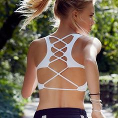 White strappy yoga tank Great Sports bra for summer or any season. Pretty crisp white. NWOT Tops