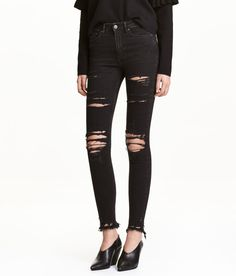 5-pocket jeans in washed stretch denim with heavily distressed details. High waist and skinny, ankle-length legs. - Visit hm.com to see more.