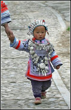 China | Miao toddler, dressed for a festival.  Near Kali, Guizhou Province. | ©Mathilde S.