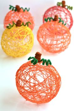 "Grab the kiddos to help you with this one! These yarn ""pumpkins"" are a simple way to make your home more festive during the fall. Get the tutorial at One Little Project At a Time. What you'll need: Jumbo Yarn ($12, amazon.com); Elmer's Glue ($1, amazon.com); Bag of Balloons ($12, amazon.com)"