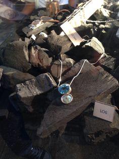 Dije de plata 950, con topacio azul y opalo andino