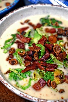 This Celery Root Soup gets a creamy chicken stock and coconut milk base that gets topped with with pan seared Pancetta, Brussels Sprouts and Toasted Hazelnuts for an amazing flavor sensation!