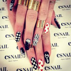 Kylie Jenner had a wonderful manicure by Japanese nail artist Miho Okawara. She had black and white nails with roses, hearts, stripes, writing and geometric design. Es Nails, Love Nails, How To Do Nails, Pretty Nails, Uñas Kylie Jenner, Alice In Wonderland Nails, Lines On Nails, Celebrity Nails, Japanese Nails