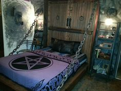 Dungeon Drawbridge platform bed and leather pillows, faux rock wall, skeleton chair and spirit wall effect. That's how I roll..