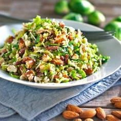 This bacon and brussel sprout salad is so good! Thinly sliced brussel sprouts, crumbled bacon, Parmesan, almonds, and shallot citrus dressing. Shaved Brussel Sprouts, Shredded Brussel Sprouts, Sprouts With Bacon, Brussels Sprouts, Kale Brussel Sprout Salad, Frango Chicken, Bacon Salad, Bacon Bacon, Sprouts Salad
