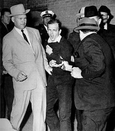 Nov. 24, 1963. In a scene captured live on network televison, Dallas nightclub owner Jack Ruby shoots and kills Lee Harvey Oswald, the accused assassin of President John F. Kennedy