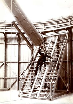 Lowell Observatory founder Percival Lowell looking through the Clark Telescope