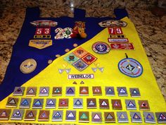 Cub Scout banner.  This is an accumulation of all of his Cub Scouting achievements, belt loops, pins, Webelos awards etc.  These do not go onto the Boy Scout uniform.  So I made a banner to hang under his Arrow of Light Award.