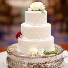 I like the look of the cake, but no flowers on the sides.  Only the top.  Only white flowers.