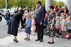 The stylish royal, who wore blue stilettos and later changed into flats, shook hands with youngsters outside the school she was opening