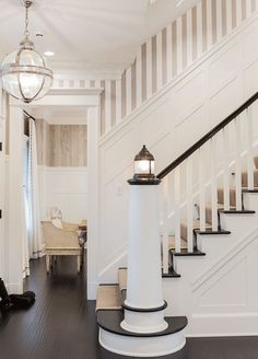 Love the lighthouses? Looking for nautical decor? Check out this staircase! This home has a beautiful lighthouse post that greets you at the stairs. Its a great way to add another light fixture and brighten up your home! #beachhousedecorcoastalstyle
