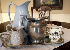 8 Budget-friendly Ways to add Farmhouse French to Your House - Cedar Hill Farmhouse. ~~~I think a tray of mixed up pitchers would be a perfect accent in my French Country dining room~~~~~