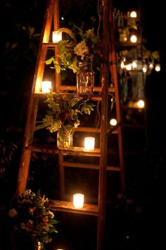 Outdoor lighting - votive candles, mason jars, wildflower bouquets, and rustic ladders = gorgeous!  LOVED ONES PICTURES ON