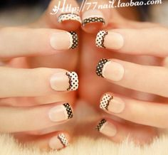 "Check out this lace themed French tip! Looking very cute and artsy, the nails are coated with a nude base and tipped with white and black polis with inverted polka dots on top. The inner edges of the French tips are also accented with lacelike designs to add more ""attitude"" to the nail tip."