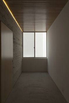 House T is a minimal home located in Japan, designed by Tsukano Architect Office. It's a white box on a busy road shields a family from noise & traffic.
