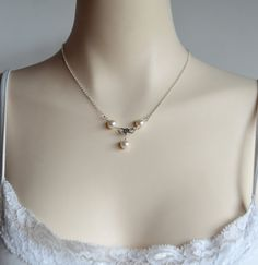 Pearl and sterling silver infinity necklace by starrydreams