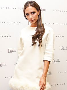 FASHION PLATE Expanding her ever-growing fashion empire, Victoria Beckham poses at an On Pedder store in Singapore on Monday, introducing shoppers there to her line for the first time.