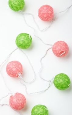 lilly pink and green light up lanterns. Perfect for adding a fun light feeling to any dorm room. String them up along your bed if you loft it or along the window which would look good for any bed setup