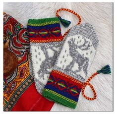 Okto mittens by Jorid Linvik, inspiration the sami artist John Savio's woodcut Okto(in northern sami) or in english - Alone. #mittenS:-) Pattern available for purchase.