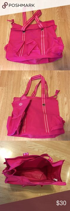 "Thirty-One Zip-top Organizing Utility Tote Zip Top Organizing Utility Tote      5 exterior pockets, 2 mesh side pockets, zip top closure, 10.75""H, 14.5""L, 6.5'D      Pattern:  Spirit Pink Thirty-One Bags Totes"