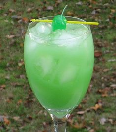 Swamp Thing #cocktail ~ Gin, Island Punch Pucker, Orange Juice & fruit to garnish.