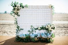 While most wedding-planning decisions focus on ceremony and reception décor, couples should also consider how they'll show guests to their seats. Typically, names of attendees and table numbers are written on escort cards and placed on a table covered with an elegant linen and topped with a towering flower arrangement; however, there are a number of ways to display seating assignments in a unique and memorable fashion. Consider choosing a seating chart or escort card display that shows ...