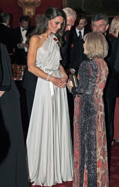 Kate spoke with dinner guests at a reception at St. James Palace, wearing a silver one-shouldered gown. via StyleList