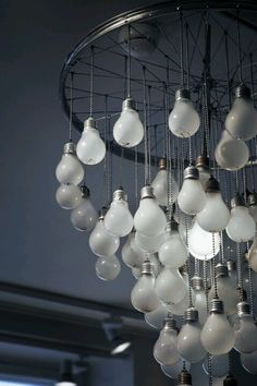 Chandelier. Or perhaps something for kids room. Add ribbon to spokes for fab baby mobile.