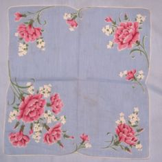 Pink carnations on blue hankie
