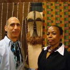 Twiga with African sculpture in the gallery.