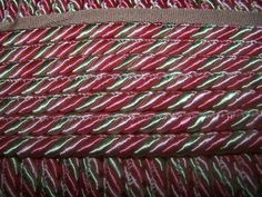 pink and green are the colors of this beautiful cord with lipSize half inch diameter, try it on pillows upholstery and moreThe listing price is for one yard.