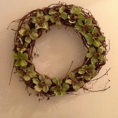 Dried hellebore blossoms on a grapevine wreath.