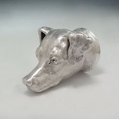 A Victorian Antique English Silver Dog's Head Stirrup Cup, Maker: Aldwinkle & Slater, London, Date: 1887, Dimensions: 5''(H), Weight: 12 oz. 16 dwt. -   Of heavy cast sterling silver, naturalistically chased as a Fox Terrier head with textured fur finish, with a plain rim. - S. J. Shrubsole, New York