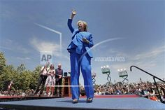 Democratic presidential candidate, former Secretary of State Hillary Rodham Clinton, right, acknowledges supporters as her husband, former President Bill Clinton, center right, their daughter Chelsea Clinton, center left, and her husband Marc Mezvinsky watch after a speech Saturday, June 13, 2015, on Roosevelt Island in New York. (AP Photo/Julio Cortez)