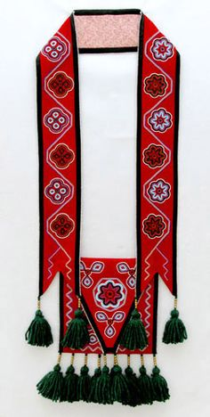 This is one of many lovely examples of modern-day bandolier beadwork by Cherokee beadworker, Martha Berry.  Exquisite.  Click through to her website and view her many other beadwork examples - you won't be disappointed!