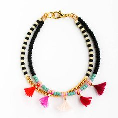 This listing is for ONE double strand friendship bracelet with 5 mini tassels in ombre red. Details: - made to order: 2-3 business days processing, - Czech/Japanese seed beads, - 24K gold plated metal beads, - cotton tassels, - designed to fit 7 wrist, approx. 7.5 long All Felt Like