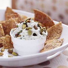 Salsa and Cheese Dip Create a chunky dip by combining sour cream with a bit of salsa and queso fresco a white, crumbly Mexican cheese. A swirl of fresh herbs and green onion add vivid flavor.